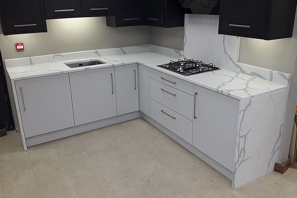 An image showing an example of a kitchen using Mason Quartz Calacatta Bold, part of the Evolved Colour Range